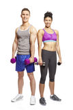 Young man and woman exercising in sports outfits Royalty Free Stock Photos