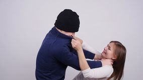 Man and woman are fighting. Terrible domestic violence in family