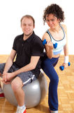 Young man and woman fitness exercising Royalty Free Stock Photos
