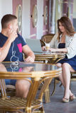 Young man and woman flirting at a cafe Stock Photography