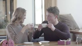 Young man and woman flirting with each other on a romantic date stock video footage