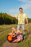 Young man and woman with guitar Royalty Free Stock Photography