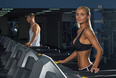 Young man and woman in the gym Royalty Free Stock Photography