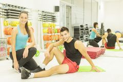 Young man and woman in the gym Stock Photos
