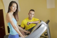 Young man and woman in the gym Stock Image