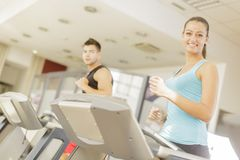 Young man and woman in the gym Stock Photography