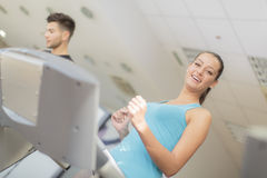 Young man and woman in the gym Stock Images