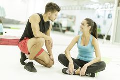 Young man and woman in the gym Royalty Free Stock Photo