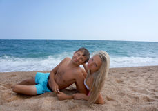 Young man and woman have a rest at the sea. Stock Photography