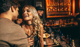 Young man and woman having good time at nightclub Royalty Free Stock Image