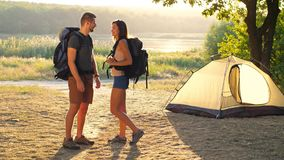 Couple with backpack on nature stock video footage