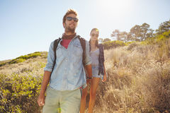 Young man and woman hiking in mountain Stock Photo