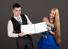 Young man and woman holding clip boards Royalty Free Stock Photo
