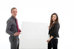 Young man and woman holding a large blank poster Royalty Free Stock Photos