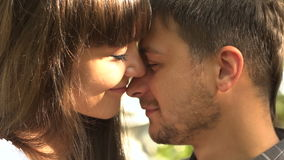 Young man and woman hug each other at the sun. Happy loving couple at the honeymoon enjoying romantic moment . Love stock video footage