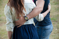 Young man and woman hugging in park Royalty Free Stock Images