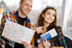 Young man and woman. Keep a map and shows the direction. Europeans. Gathered in a guided tour. Close-up. Honeymoon Stock Photos