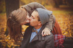 The young man and woman kisses in a park royalty free stock image