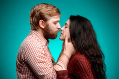 Young man and woman kissing Royalty Free Stock Photo