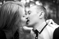 Young man and woman kissing outdors Royalty Free Stock Photography