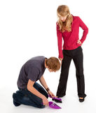Young man and woman, he kneeling before she Stock Photos