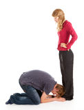 Young man and woman, he kneeling before she Royalty Free Stock Photos