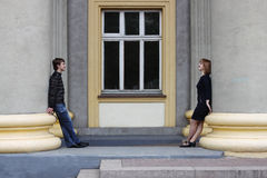 Young man and woman is looking on each other. Royalty Free Stock Photography