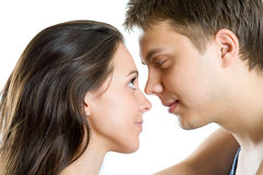 Young man and woman looking for tenderness Royalty Free Stock Photos