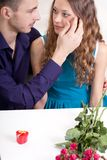 Young man and woman looking to each other Royalty Free Stock Images