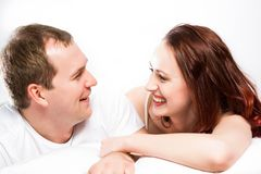 Young man and woman lying together in bed Stock Photo