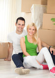 Young man and woman with moving boxes royalty free stock image
