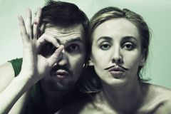 Young man and  woman with  mustache Royalty Free Stock Photography