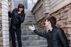 Young man and woman outdoors Stock Photos
