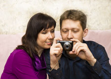 Young man and woman with photocamera Stock Photography