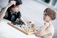 Young man and woman playing chess Stock Photo