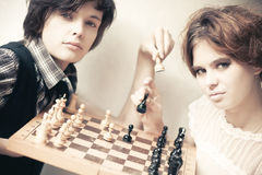Young man and woman playing chess Royalty Free Stock Photography