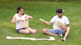 Young man and woman playing giant dominoes in Park stock footage