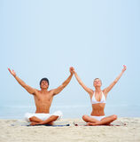 Young man and woman practicing yoga Royalty Free Stock Image
