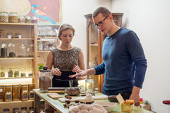Young man and woman in the private sellers store Stock Photo