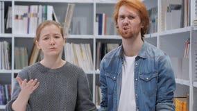 Young Man and Woman Reacting to Loss, Camera View stock image