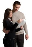 Young man and woman read letter. Happy young man and woman read letter Royalty Free Stock Photos