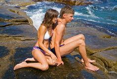 Young man and woman on reef 4 Royalty Free Stock Images