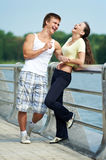Young man and woman relaxing after Royalty Free Stock Images