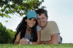 Young man and woman relaxing outside Royalty Free Stock Images