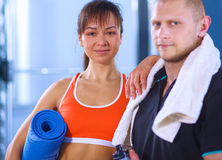 Young man and woman relaxing in sports outfits at Stock Photo