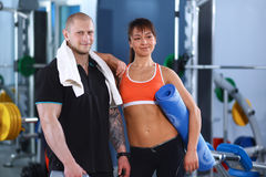 Young man and woman relaxing in sports outfits at Royalty Free Stock Image