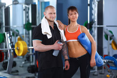 Young man and woman relaxing in sports outfits at Stock Photography