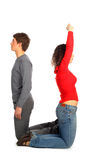 Young man and woman represents  letter u Stock Photography