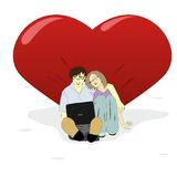 Young man and woman resting at a big heart Stock Photos