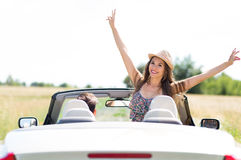 Young man and woman riding in convertible car Royalty Free Stock Photo
